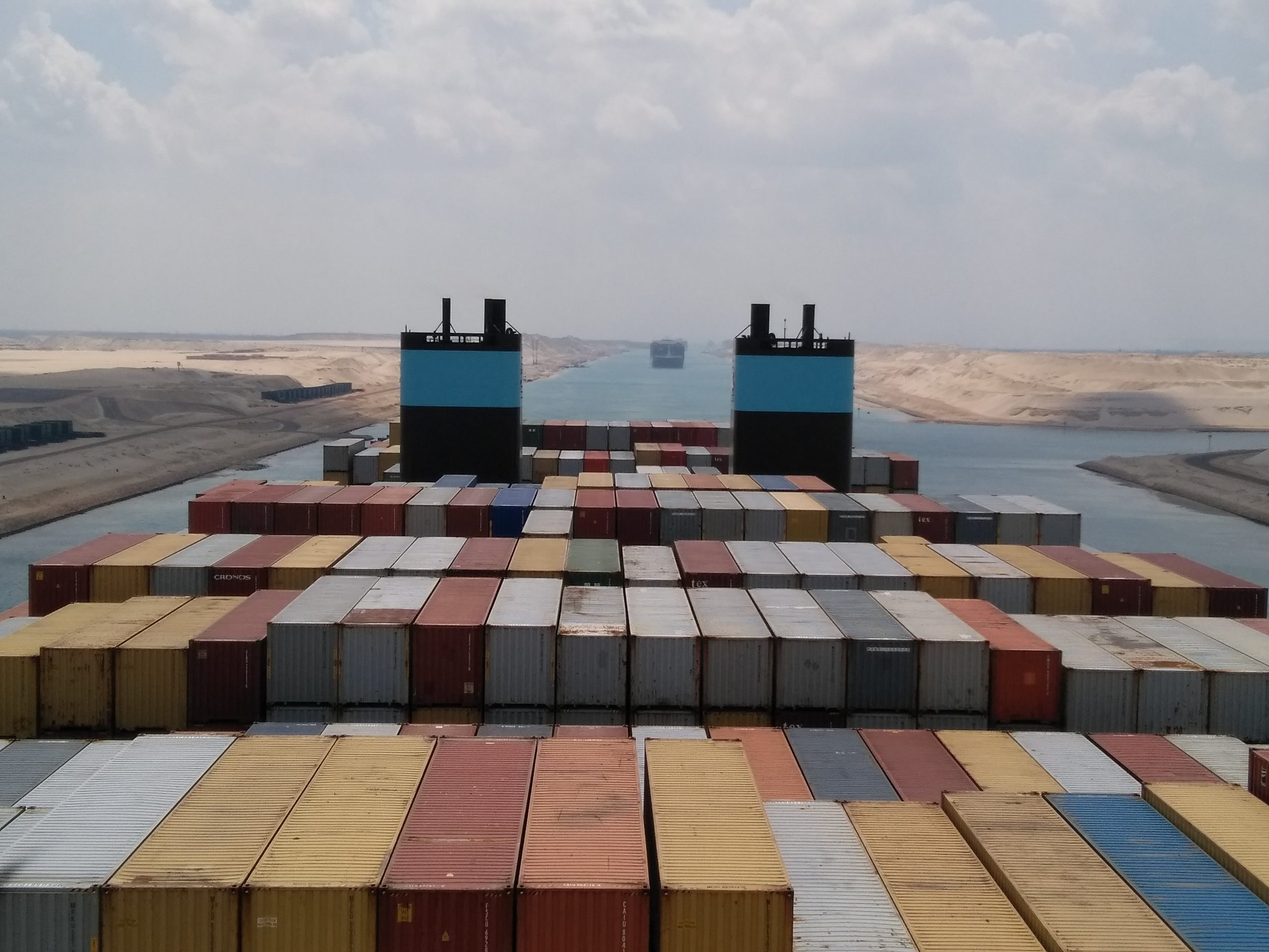 PIC: Passing between the hot desert sands of the Suez Canal, Egypt